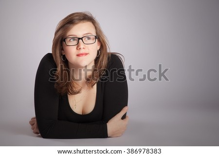 Young woman is laying on the floor