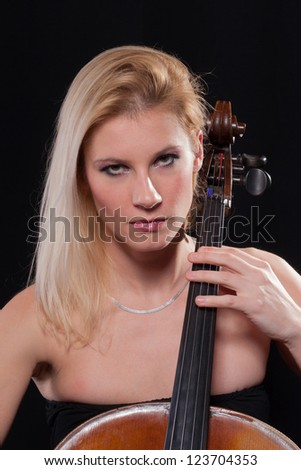 young woman is playing cello