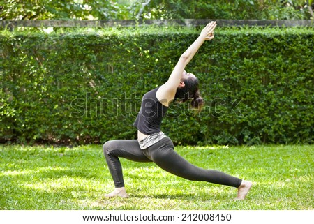 Young woman is practicing yoga at the park