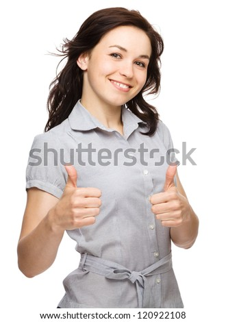 Young woman is showing thumb up gesture using both hands, isolated over white - stock photo