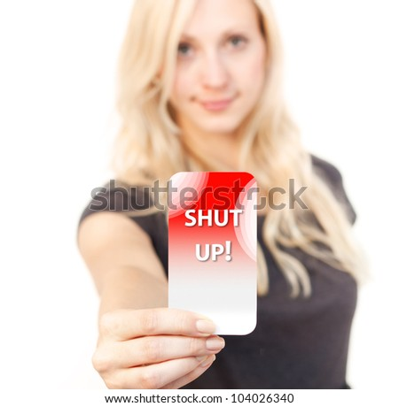 Young woman is smiling while showing a shut up! Card - stock photo