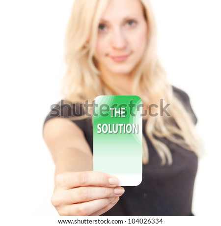 Young woman is smiling while showing a solution Card - stock photo
