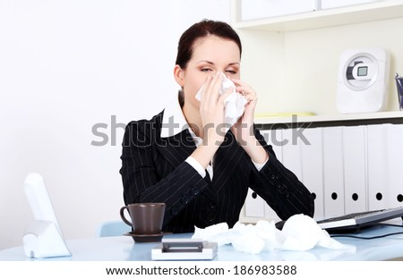 Young woman is sneezing. Illness concepion. - stock photo