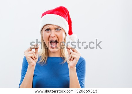 Young woman is very angry because of her addiction to cigarettes and she decided to start a new life without cigarettes in the new year.New Year's stop smoking resolution