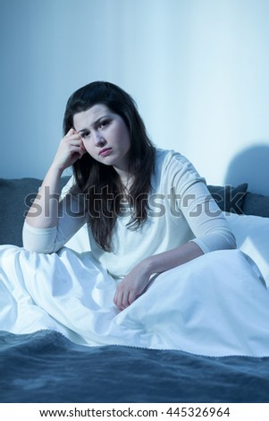 Young woman is very depressed during a winter  - stock photo