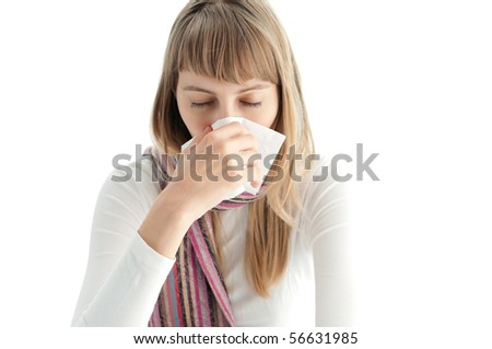young woman isolated on white background got cold and blowing her nose in handkerchief