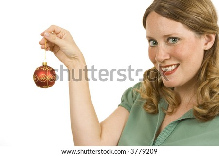 Young woman isolated on white holding a Christmas decoration