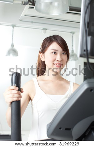 young woman jogging in a gym