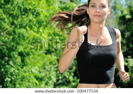 Young woman jogging in nature - stock photo