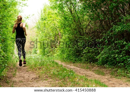 Young woman jogging in the nature