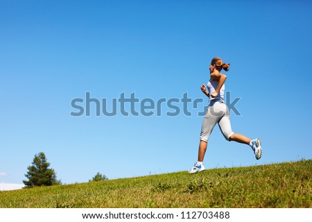 Young woman jogging in the park. Health and fitness.