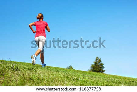 Young woman jogging in the park. Health and fitness. - stock photo