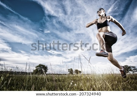Young woman jogging in the summer park - stock photo