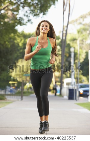 Young Woman Jogging On Street