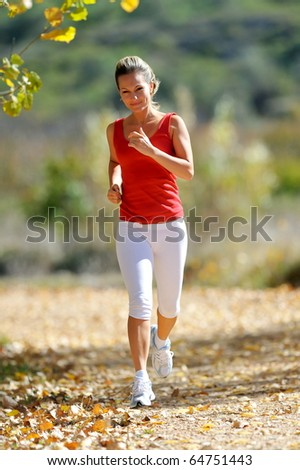 young woman jogging outdoor in summer - stock photo