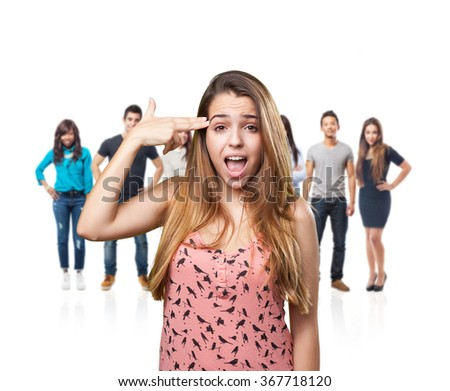 young woman joking doing a suicide gesture - stock photo