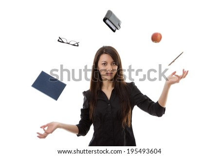 young woman juggling different objects