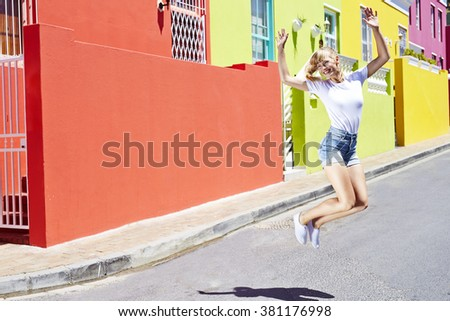 Young woman jumping in street