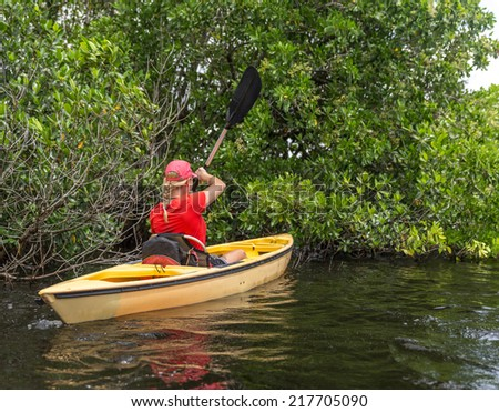 Young woman kayaking in Everglades National park, Florida, USA - stock photo