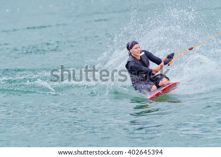 Young woman kneeboarding