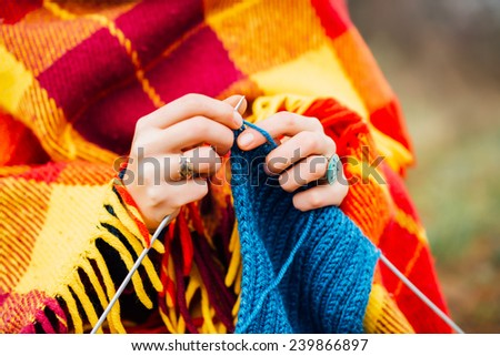 Young woman knitting
