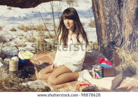 young woman knitting - stock photo