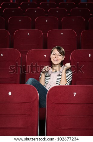 Young woman laughing at funny scene - stock photo