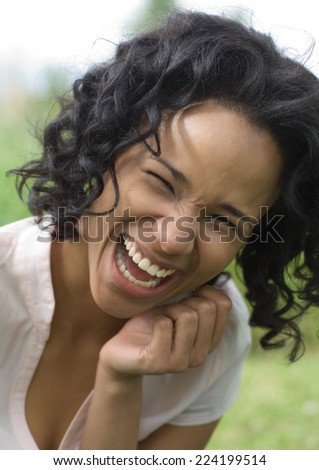 Young woman laughing, portrait