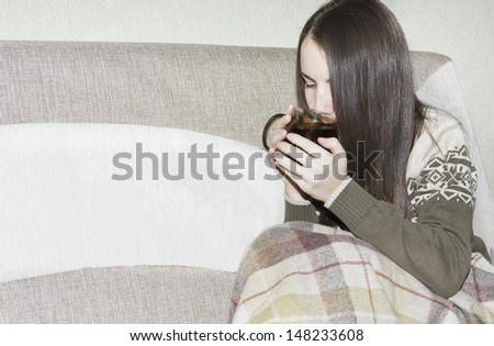 Young woman laying in bed, caught cold, feeling bad, drinking tea - stock photo