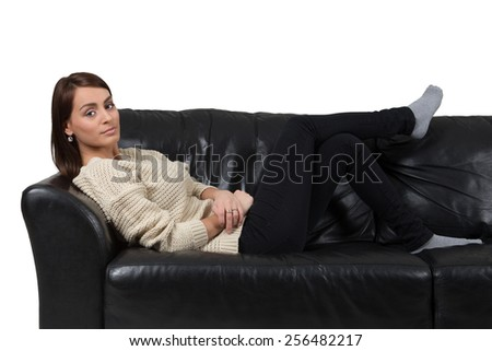 Young woman laying on sofa.