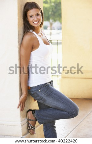Young Woman Leaning Against Pillar