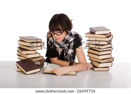 Young woman learning and reading between two pile of books - stock photo