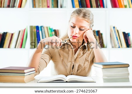 Young woman learning in library
