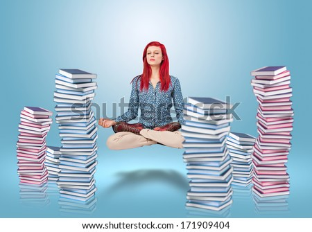 young woman levitating due to her knowledge - stock photo
