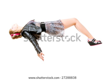 young woman levitating. isolated over white background