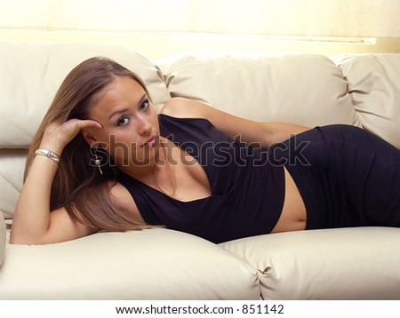 young woman lied on couch