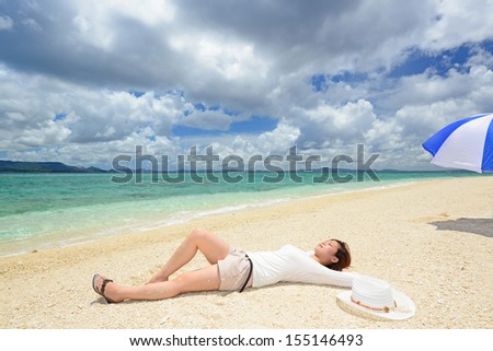 Young woman lies on the beach