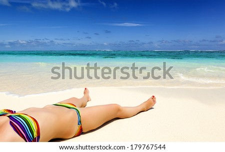 young woman lies on the shore of a tropical sea. on white sand. vacation in the Caribbean. girl on the beach Bahamas. young woman on the Hawaiian beach