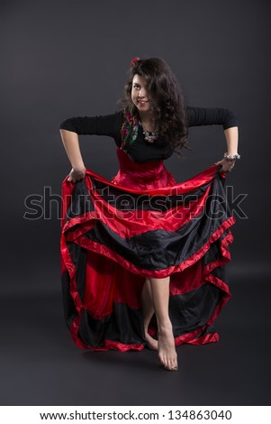 Young  woman lift up spanish traditional clothe skirt