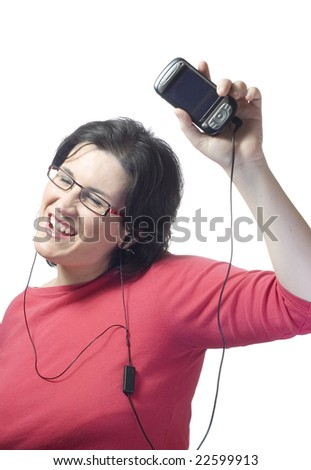 young woman listening, dancing and singing to music in a mp3 device