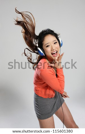 young woman listening music - stock photo