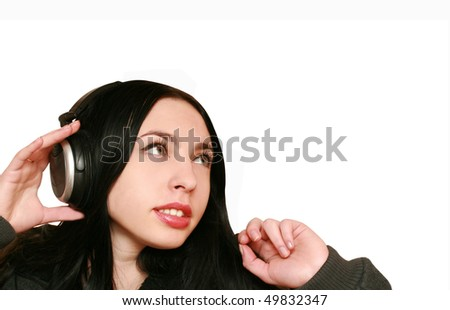 young woman listening music in headphones