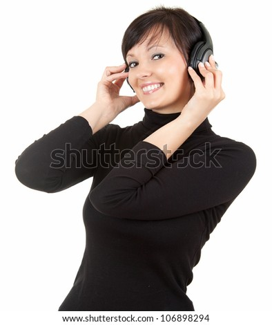 young woman listening music in headphones, white background