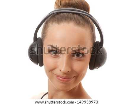 young woman listening music with headphones, isolated on white