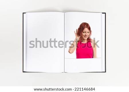 Young woman listening printed on book - stock photo