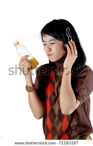 Young woman listening the music and enjoy with her soft drink isolated on white background