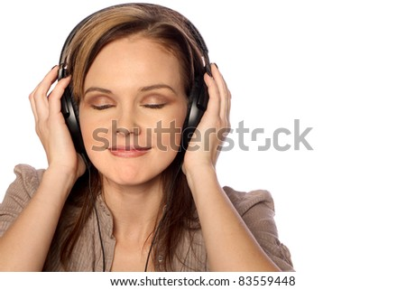 Young woman listening to music and smiling