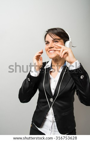 young woman listening to music, dancing