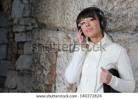 Young woman listening to the music