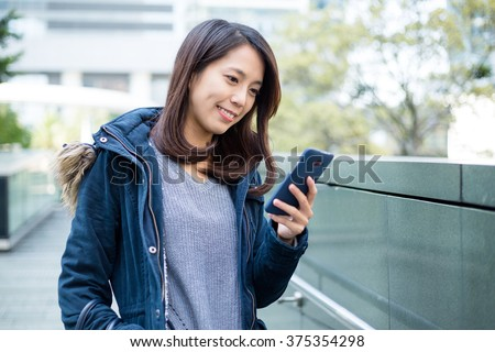 Young woman look at cellphone - stock photo